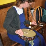 Ruth Stringing her banjo